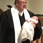 Rev. David Slaughter during baptism